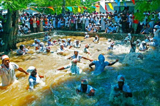 Haitians take a cleansing dip in the Ma bath (Rituals)