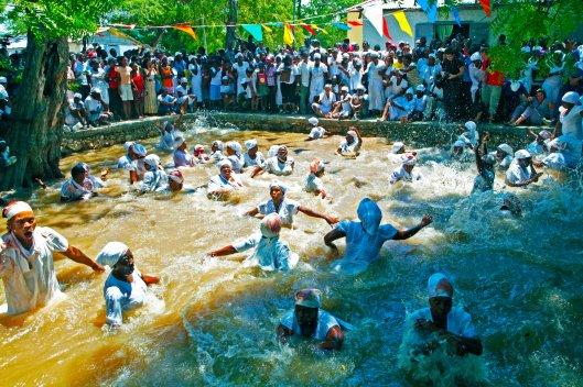 Haitians take a cleansing dip in the Ma bath (Rituals)